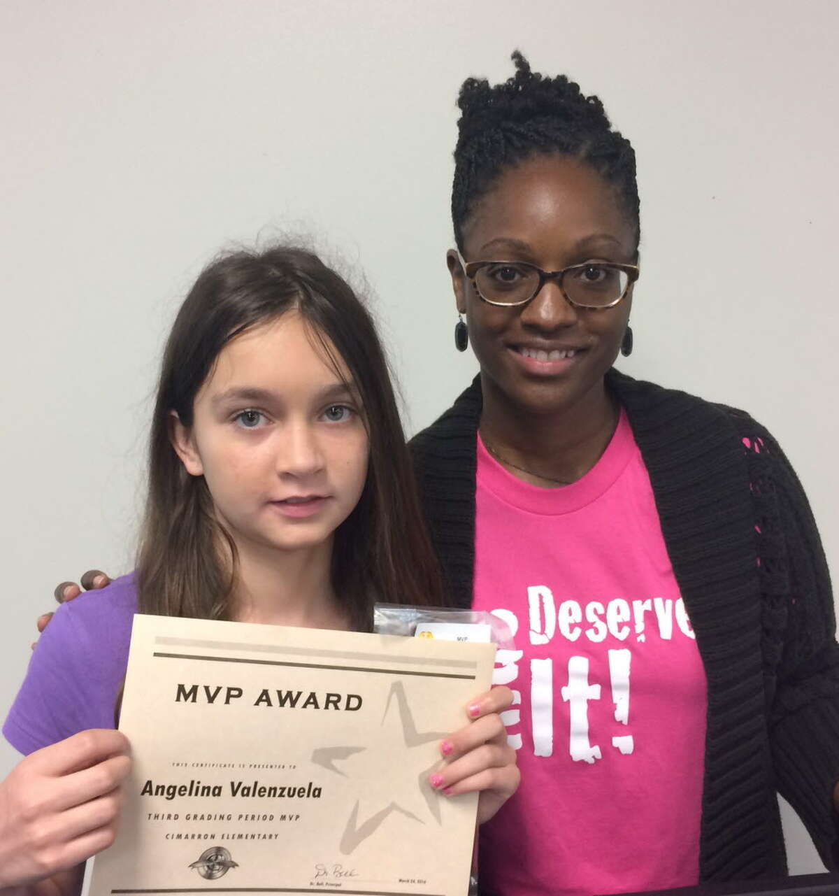 Cimarron Elementary Student Angelina Valenzuela with principal Sanee Bell.