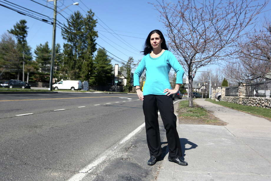 Stamford resident Christina Fiorvanti is lobbying the city to make safety changes, including adding school signs, to reconfigure traffic flow into and out of Our Lady of Grace School on Glenbrook Road in Stamford, Conn. Pictured is Ms. Fioravanti in front of the school, where she was involved in a minor car accident, on Wednesday, March 30, 2016. Photo: Michael Cummo / Hearst Connecticut Media / Stamford Advocate