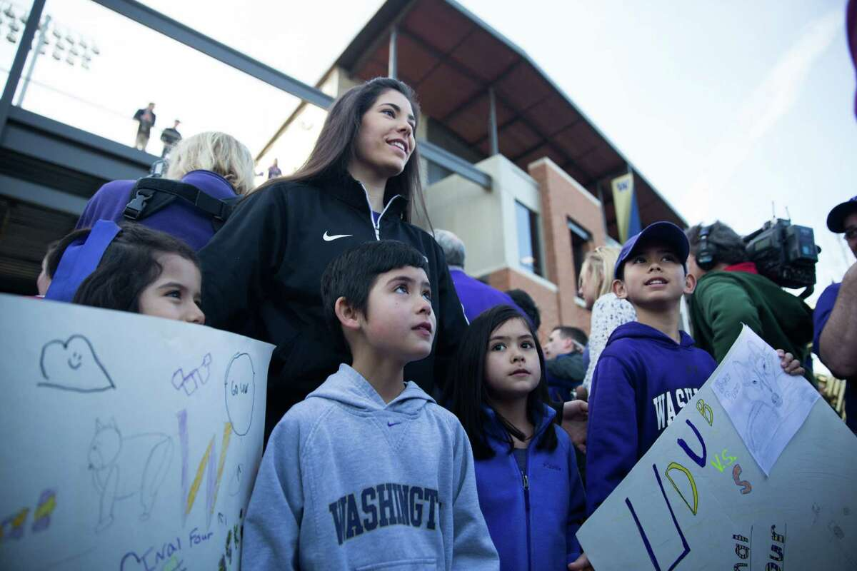 University of Washington's Kelsey Plum visits with young fans gathered to send the team off for their Final Four appearance, at Husky Stadium, Thursday, Mar. 31, 2016.