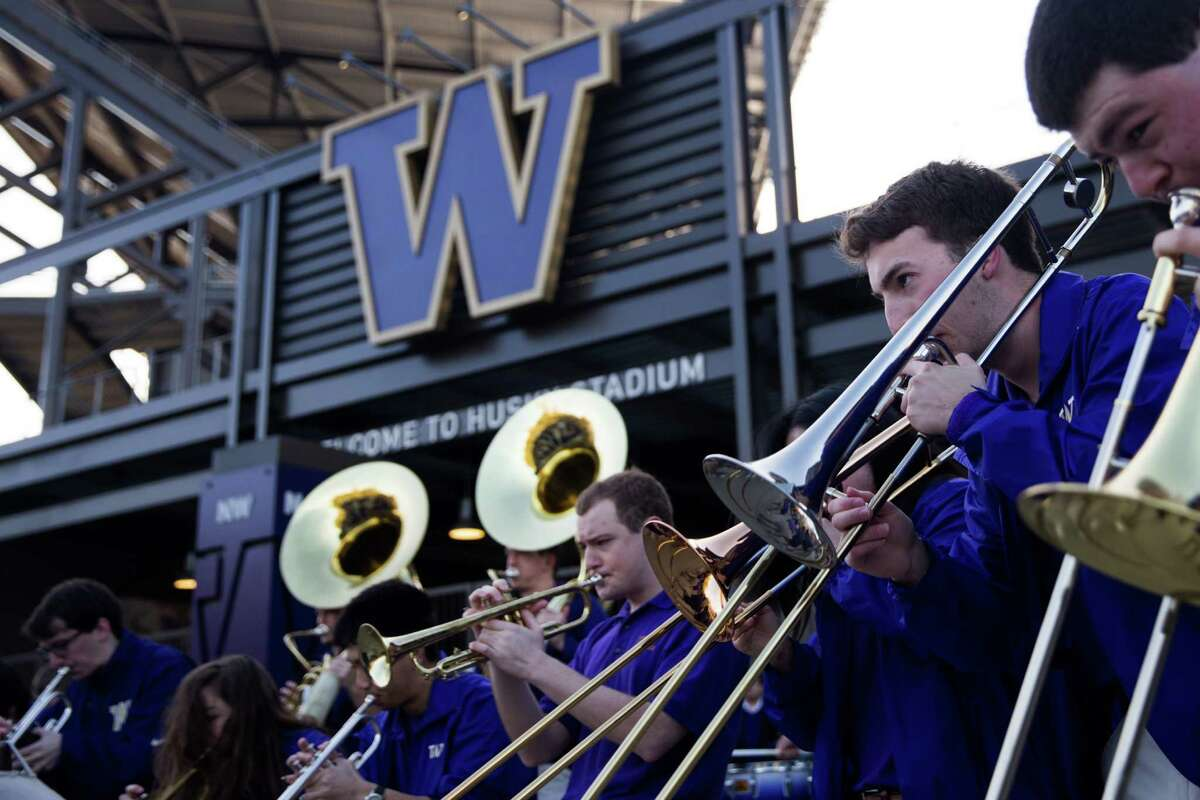 The Husky marching band plays as fans gather to send off the University of women's basketball team for their first ever Final Four appearance, at Husky Stadium, Thursday, Mar. 31, 2016.