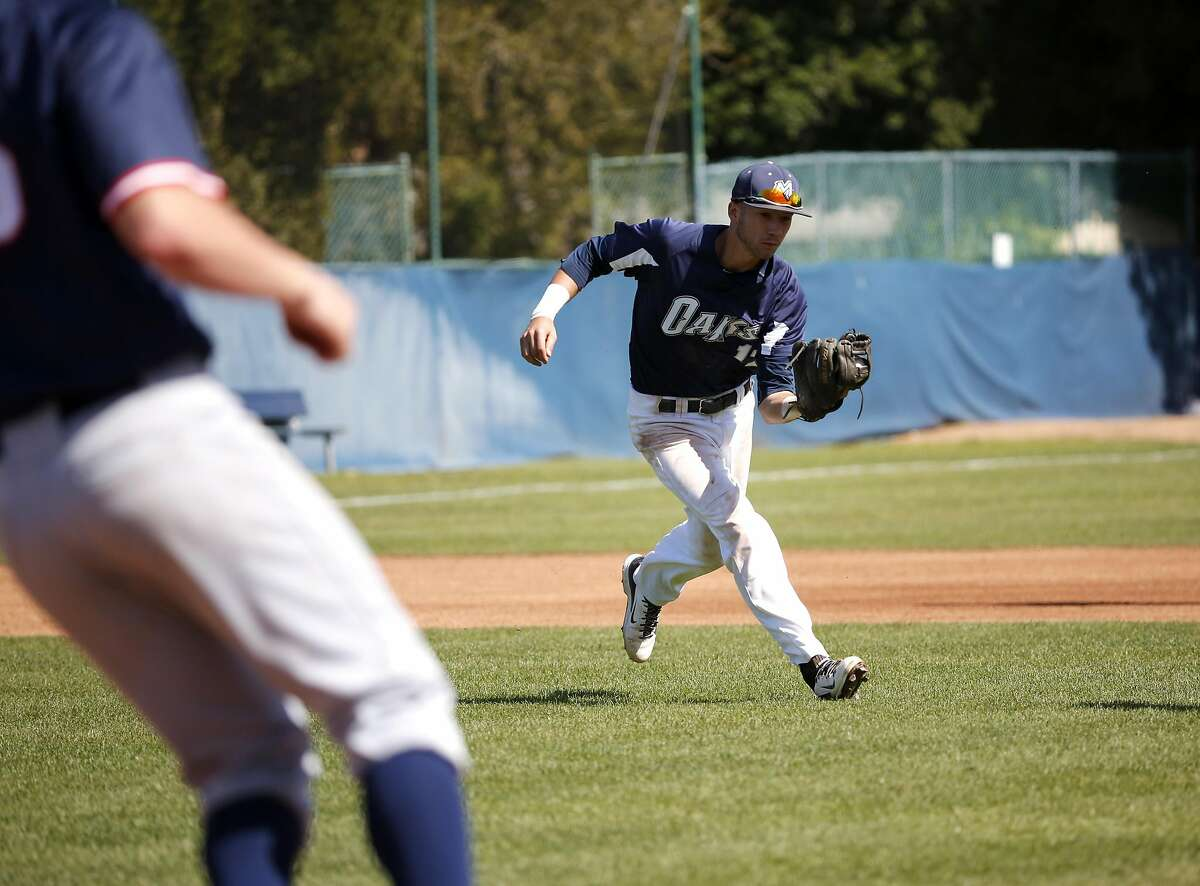 Lucas Erceg (17) catches a pop up running in from his position at third base during Menlo College's game against Lewis-Clark State College in Atherton, California, on Wednesday, March 30, 2016.
