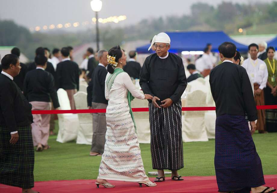 Aung San Suu Kyi is welcomed by new Myanmar President Htin Kyaw during a dinner reception following a swearing-in ceremony in the capital, Naypyidaw. Photo: YE AUNG THU, AFP/Getty Images
