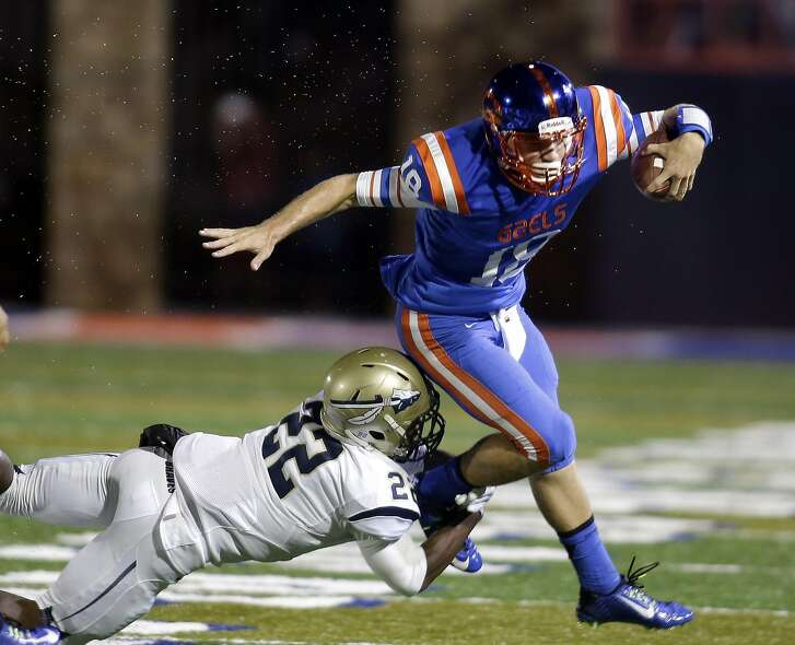 FILE - In this Sept. 26, 2014, file photo, Bishop Gorman quarterback Tate Martell is tackled by St. John Bosco's Clifford Simms during the first half of a high school football game in Las Vegas. Martell, the nation's No. 2 junior quarterback according to the 247Sports Composite, has verbally committed to Texas A&M. (AP Photo/Isaac Brekken, File)