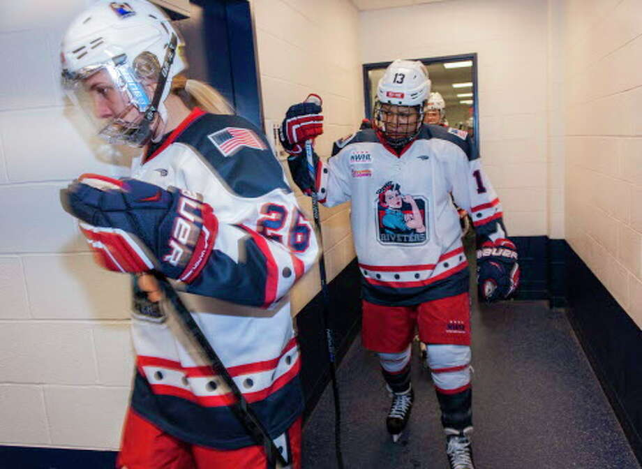 Former Fairfield resident Kiira Dosdall (26) heads to the ice to play with the New York Riveters prior to a recent National Women's Hockey League game against the Connecticut Whale at Yale's Ingalls Rink. Photo: Mark Conrad / For Hearst Connecticut Media / Connecticut Post Freelance