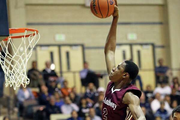 Jackets big man Charles Bassey throws down a slam as Central Catholic plays St. Anthony in boys basketball at Greehey Arena on January 21, 2016.