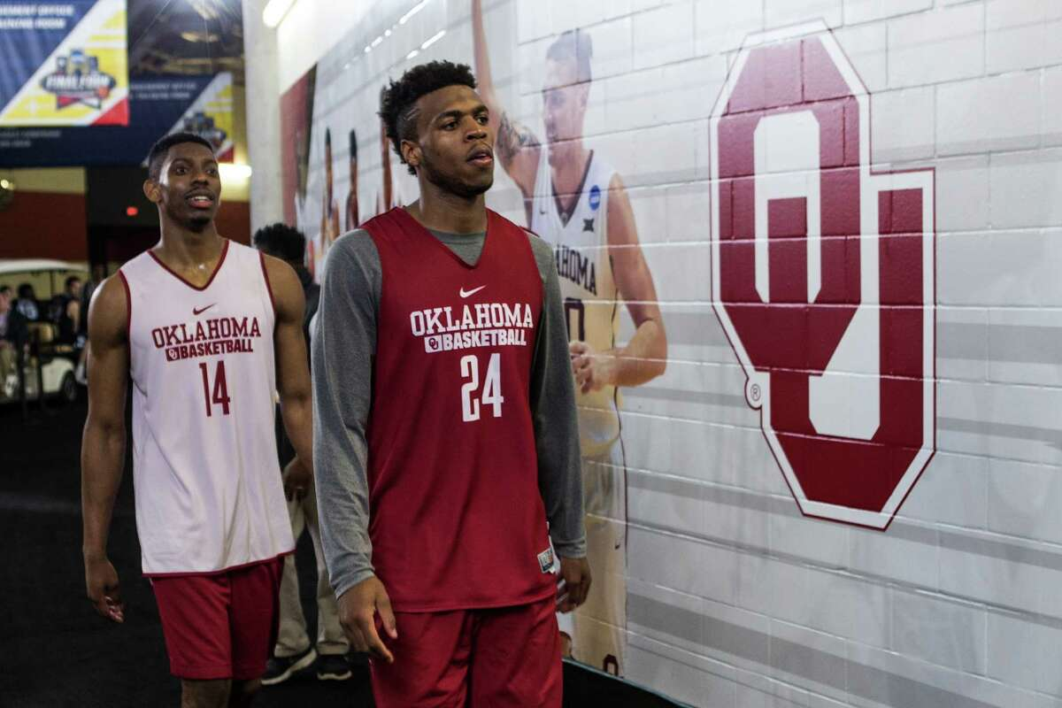 Oklahoma guard Buddy Hield (24) and guard Bola Alade (14) walk back to the Oklahoma locker room following practice for the NCAA national semifinal at NRG Stadium on Thursday, March 31, 2016, in Houston.