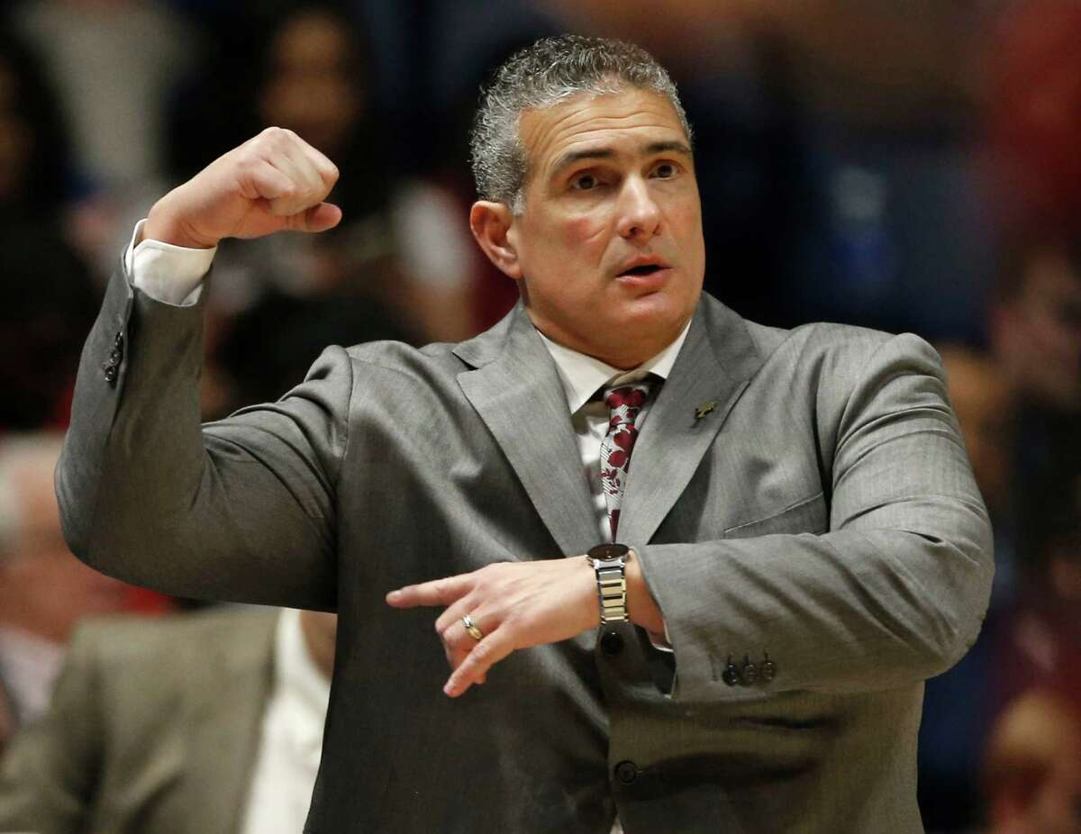 South Carolina head coach Frank Martin directs his team against Georgia during the first half of an NCAA college basketball game in the Southeastern Conference tournament in Nashville, Tenn., Friday, March 11, 2016.