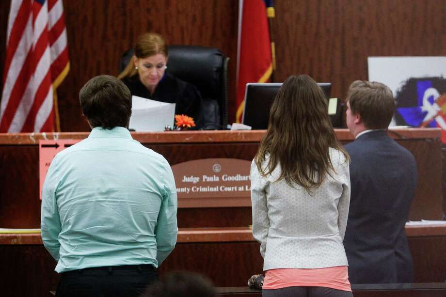 One of the eight prostitutes, second from right, alleged to be connected to the United Airlines pilot who was accused of running a prostitution ring appeared in front of Judge Paula Goodhart in misdemeanor court Thursday, March 31, 2016 in Houston. Photo: Michael Ciaglo, Houston Chronicle / © 2016  Houston Chronicle