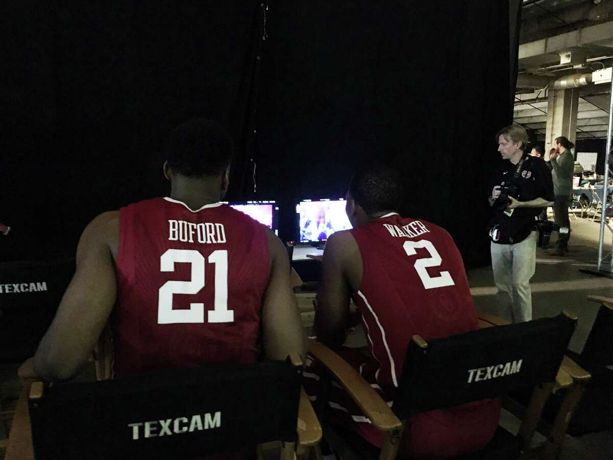 Oklahoma's Dante Buford and Dinjiyl Walker watch their teammates film their intro videos for TBS on Thursday at NRG Stadium.