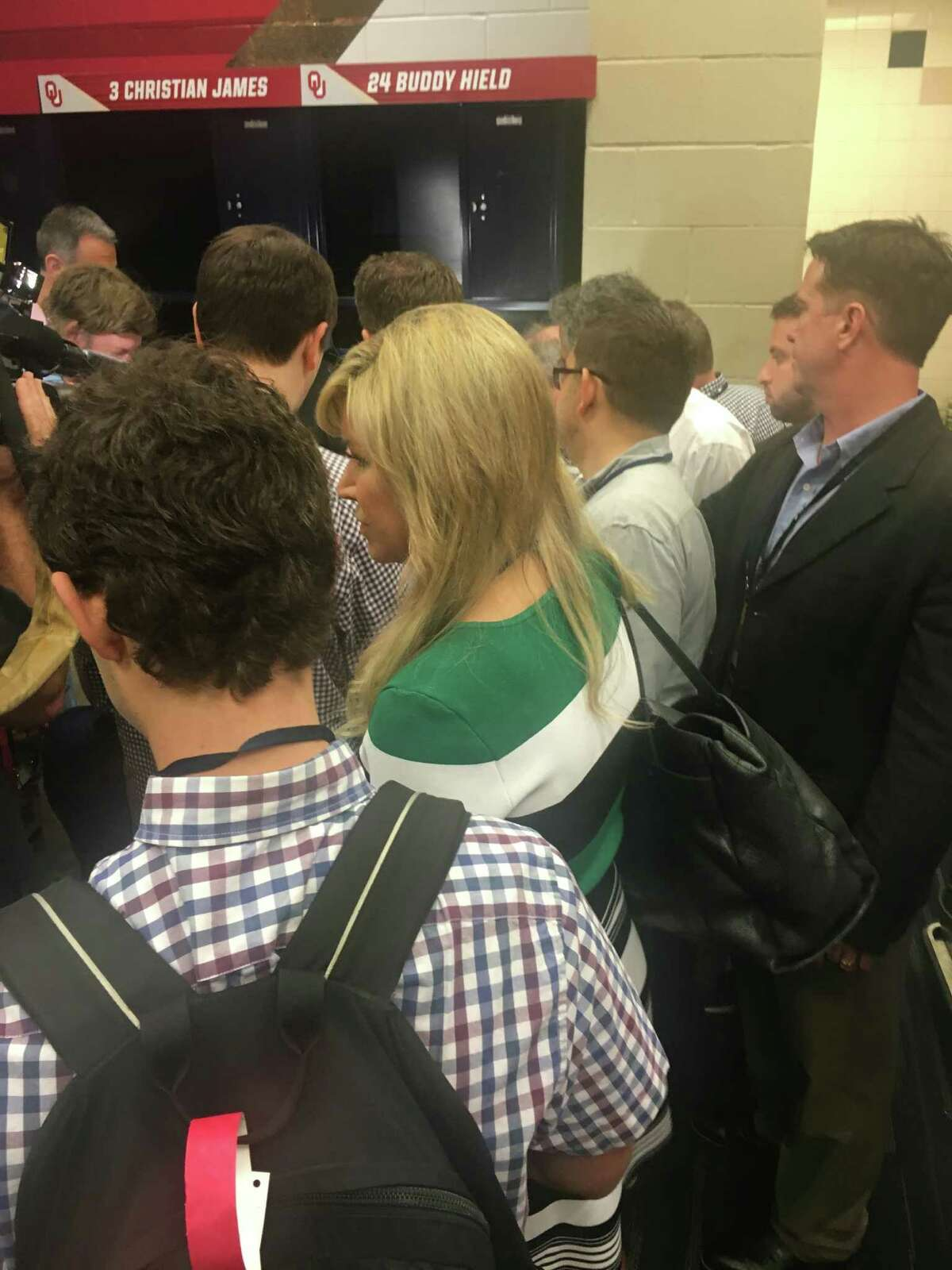 Oklahoma star Buddy Hield is swarmed by the media during the Sooners' media availability Thursday at NRG Stadium.
