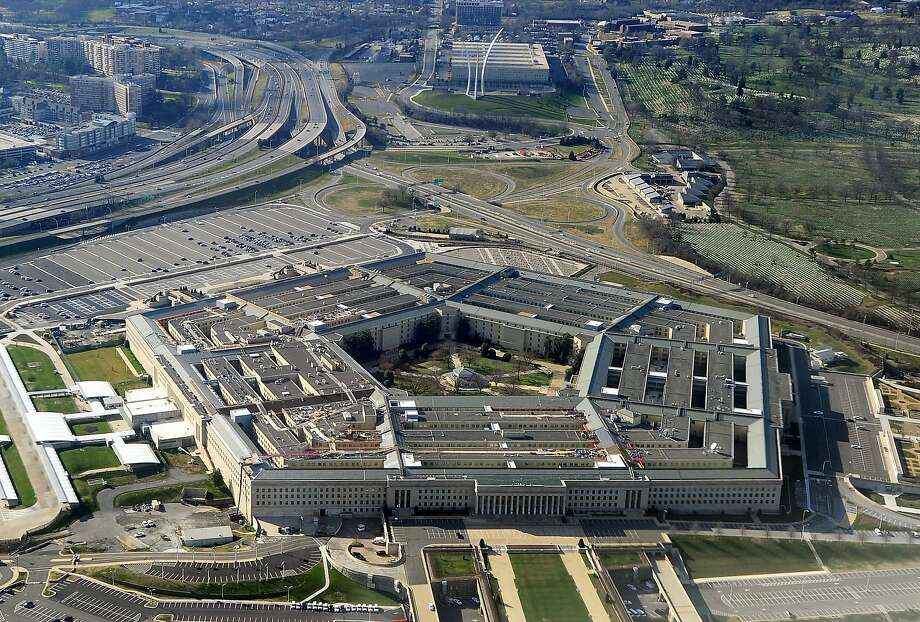 "(FILES) This file photo taken on December 26, 2011 shows the Pentagon building in Washington, DC.  Ever wanted to hack Uncle Sam? Provided you're American and can pass a background check, go right ahead, the Pentagon said March 2, 2016.The US Department of Defense is inviting vetted hackers to test its cybersecurity under a pilot program that is the first of its kind in the federal government. Called ""Hack the Pentagon,"" the so-called bug bounty program will give cash awards and other recognition to participants who can spot weaknesses on the Pentagon's public web pages.   / AFP / STAFFSTAFF/AFP/Getty Images Photo: STAFF, AFP / Getty Images"