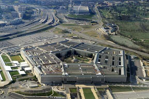 "(FILES) This file photo taken on December 26, 2011 shows the Pentagon building in Washington, DC.  Ever wanted to hack Uncle Sam? Provided you're American and can pass a background check, go right ahead, the Pentagon said March 2, 2016.The US Department of Defense is inviting vetted hackers to test its cybersecurity under a pilot program that is the first of its kind in the federal government. Called ""Hack the Pentagon,"" the so-called bug bounty program will give cash awards and other recognition to participants who can spot weaknesses on the Pentagon's public web pages.   / AFP / STAFFSTAFF/AFP/Getty Images"