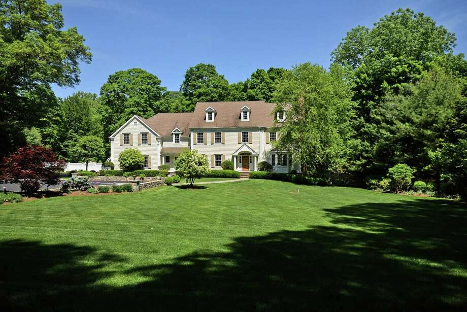 This classic five-bedroom colonial on Valley Road offers a quiet East Side locale alongside the Silvermine River. Photo: Contributed Photos / New Canaan News