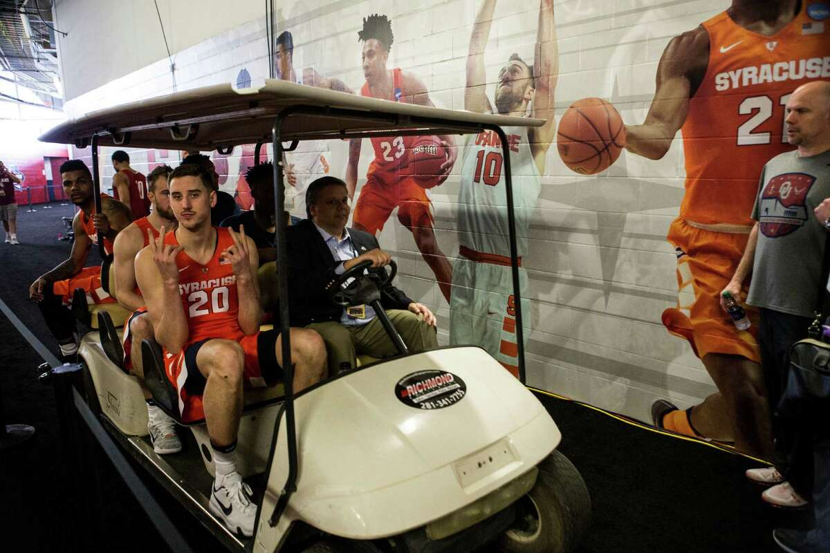 Syracuse forward Tyler Lydon (20) rides in a cart on the way to a media session at NRG Stadium on Thursday, March 31, 2016, in Houston.