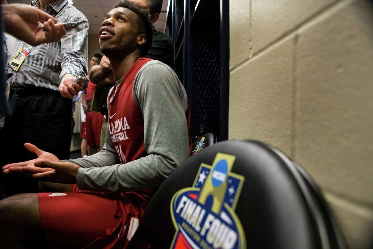 Oklahoma guard Buddy Hield speaks to the media in the Sooners' locker room following practice for the NCAA national semifinal at NRG Stadium on Thursday, March 31, 2016, in Houston.