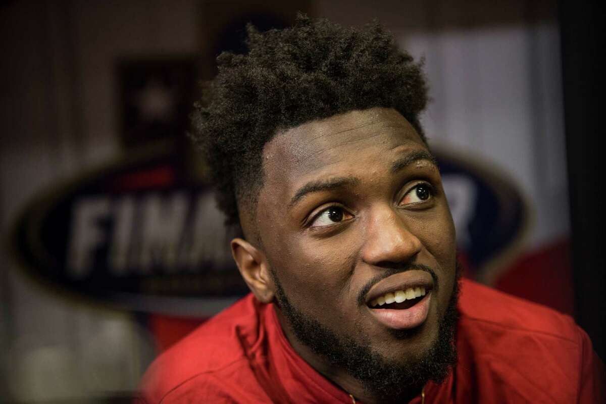 Oklahoma forward Khadeem Lattin (12) does an interview after practice for the NCAA national semifinal at NRG Stadium on Thursday, March 31, 2016, in Houston.