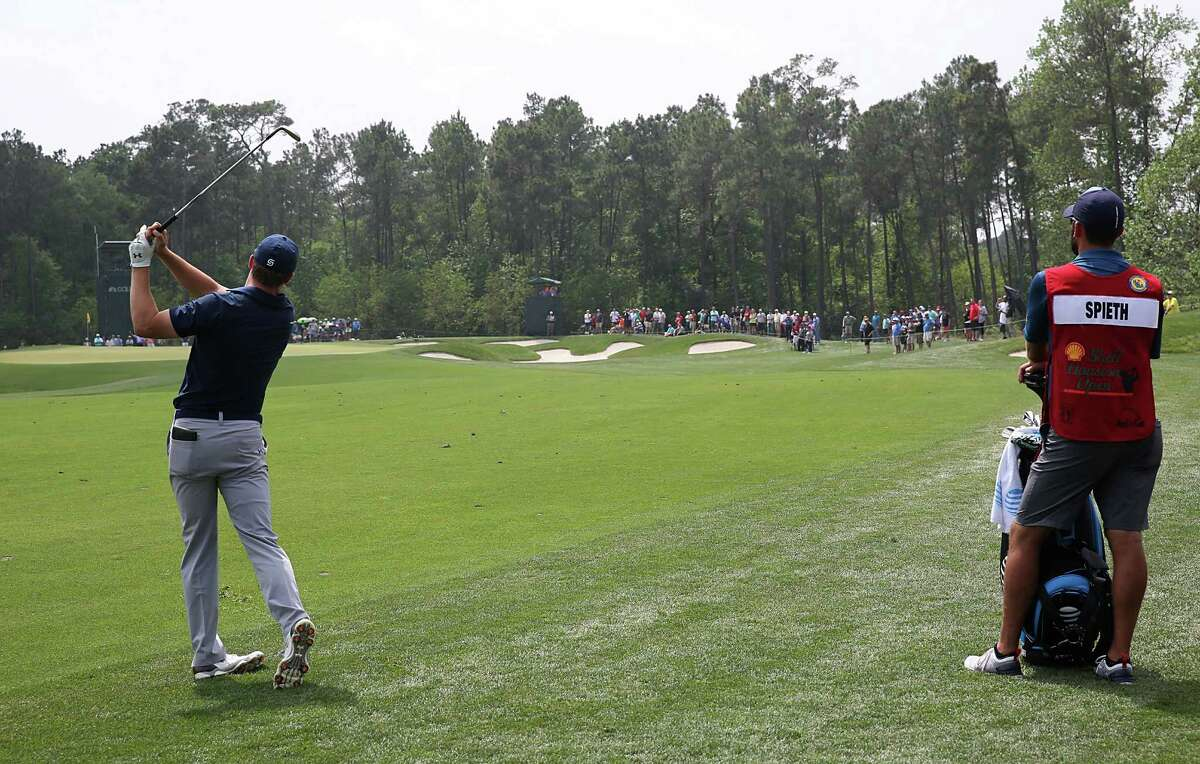 Jordan Spieth hits an approach shot on the 4th fairway in the Shell Houston Open-Round 1 at the Golf Club of Houston on Wednesday, March 31, 2016 in Humble, TX.