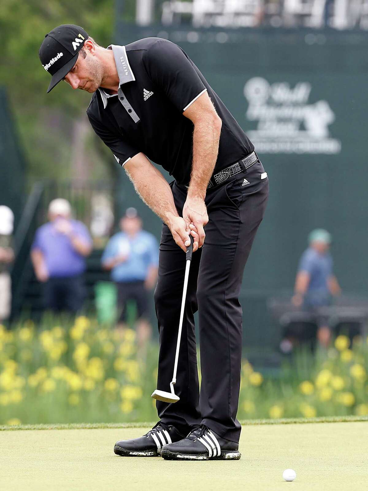 Dustin Johnson puts on the 18th green in the Shell Houston Open-Round 1 at the Golf Club of Houston on Wednesday, March 31, 2016 in Humble, TX.