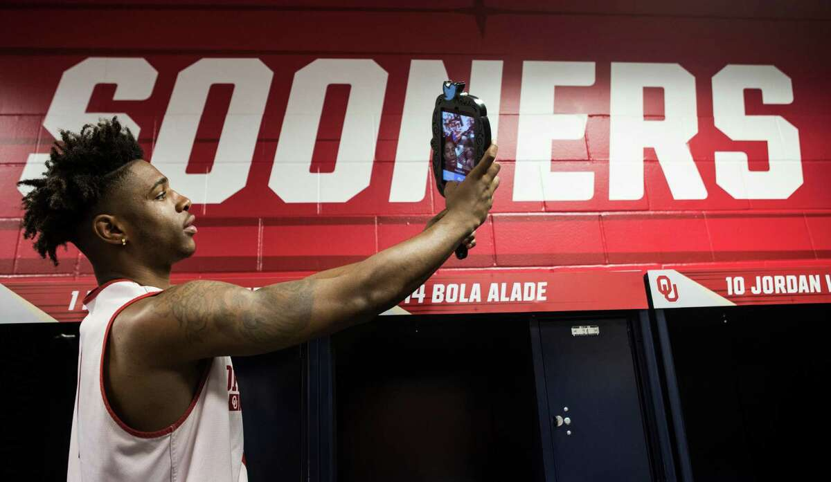 Oklahoma guard Rashard Odomes (1) takes a selfie in the locker room after practice for the NCAA national semifinal at NRG Stadium on Thursday, March 31, 2016, in Houston.