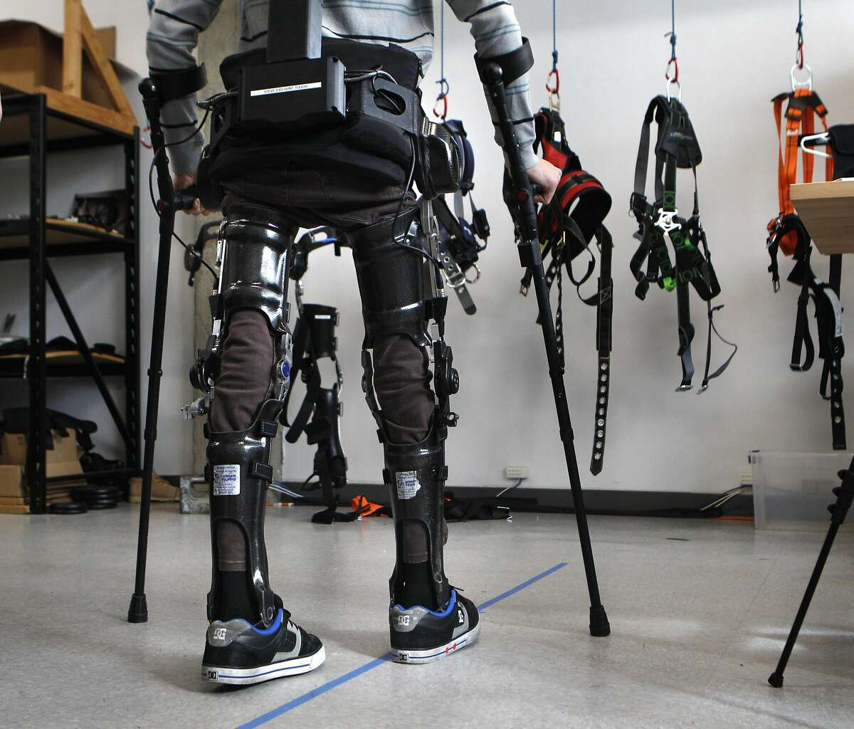 Steve Sanchez, who was paralyzed from the waist down in a BMX accident, test walks the latest robotics suit from SuitX, the Phoenix device, at their offices in Berkeley, Calif., on Thursday March 31, 2016. This suit allows people who have been paralyzed, or have limited mobility, to walk again. This latest suit technology is considered to be the lightest and cheapest at $40,000.