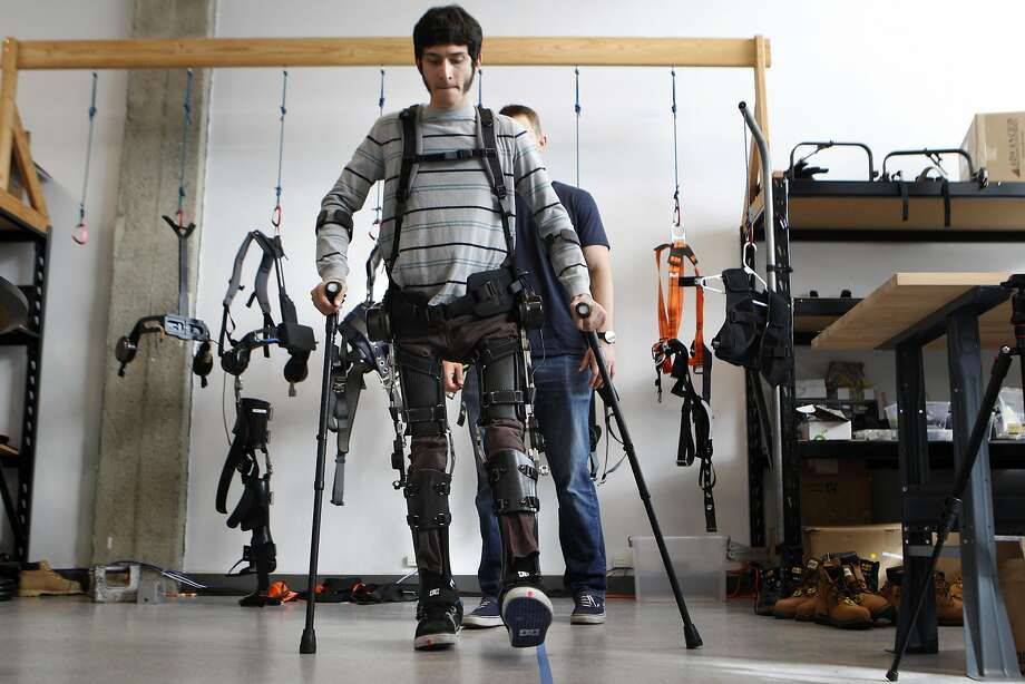 Steve Sanchez, who was paralyzed from the waist down in a BMX accident, test walks SuitX's Phoenix device. Photo: Brittany Murphy, The Chronicle