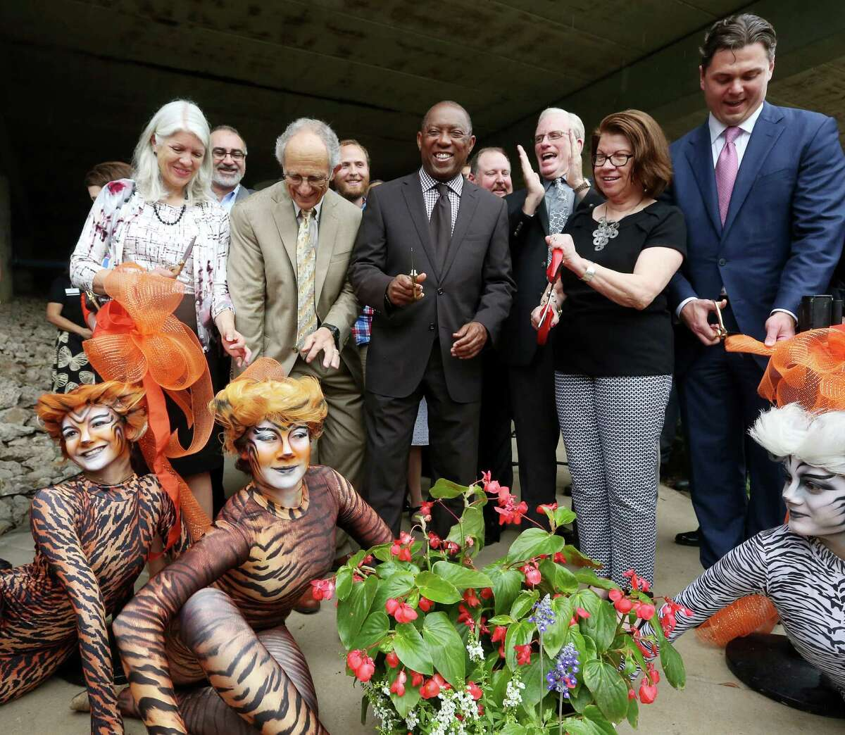 District H. Council Member Karla Cisneros, from front left, Mike Garver, Mayor Sylvester Turner, Joe Turner, Anne Olson and Collin Cox, cut a ribbon during a ceremony celebrating the opening of a new part of the Buffalo Bayou Path between Smith Street and Travis Street, Thursday, March 31, 2016, in Houston.