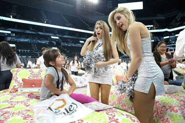"Carolina Velasquez, sitting on her new bed, tells Silver Dancers Brittany (right) and Lauren, ""You are beautiful."""