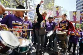 Marisa Salas, center, chants with others at a rally in support of raising the minimum wage to $15 an hour in Oakland, Calif., on Thursday, March 31, 2016.