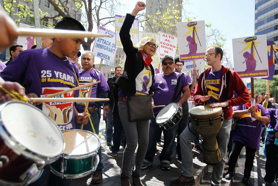 Marisa Salas (center) shows her enthusiasm at an Oakland rally for the minimum-wage hike. Photo: Mathew Sumner, Special To The Chronicle