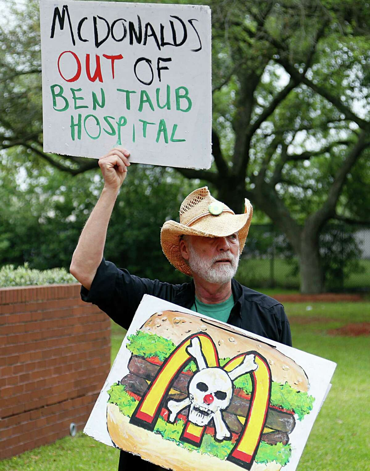 """Value the Meal volunteer Don Cook demonstrates in front of Harris Health System's offices. """"McDonald's has been a good partner, and offers a variety of healthful menu options to our visitors and staff,"""" George Masi of Harris Health System said in a statement."""