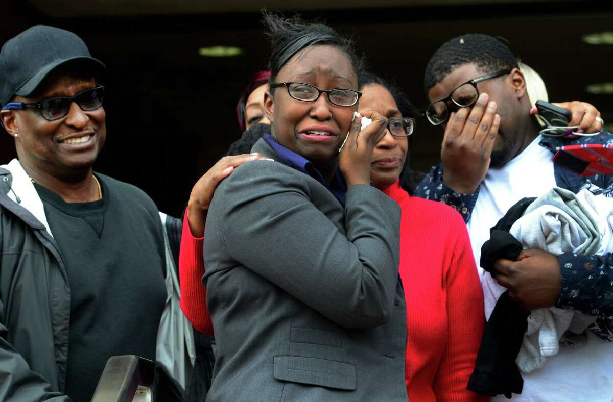 Cherelle Baldwin, a young mother who claims she crushed her abusive boyfriend Jeffrey Brown with her car in self-defense, was found not guilty at Superior Court on Main Street in Bridgeport, Conn., on Thursday Mar. 31, 2016. Cherelle, standing in center, stands with her father Bernard Baldwin Sr., at left, mom Cynthia Long, and brother Bernard Baldwin Jr., at right, outside of the courthouse after the verdict.