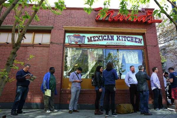 People began arriving before the 11 a.m. opening to get a table at Mama's Mexican Kitchen on the restaurant's last day in business, Mar. 31, 2016.  Mama's has been a Belltown fixture for over forty years.
