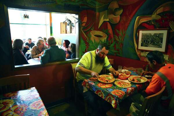 Diners eat lunch at Mama's Mexican Kitchen on the restaurant's last day in business, Mar. 31, 2016.  Mama's has been a Belltown fixture for over forty years.