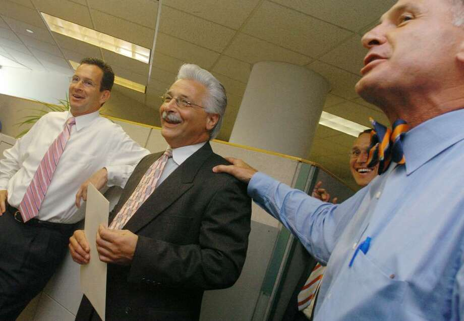 FILE –Fred Manfredonia, is honored during an employee of the month event in 2005. Photo: File Photo / Stamford Advocate File Photo