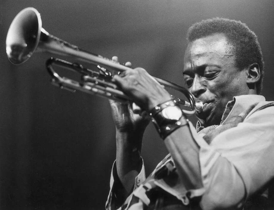 Jazzman Miles Davis plays the trumpet in 1955. Photo: Express Newspapers, Getty Images
