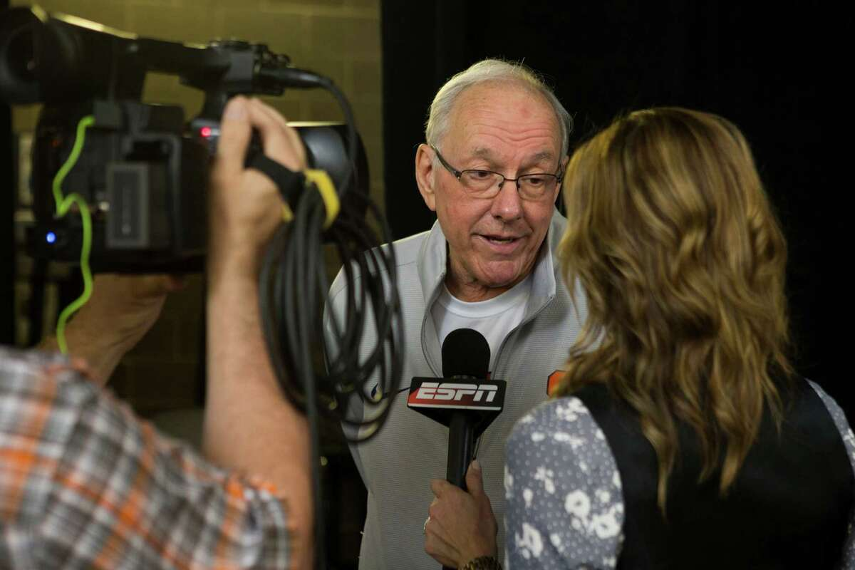 Syracuse head coach Jim Boeheim speaks to a television reporter following practice for the NCAA national semifinal at NRG Stadium on Thursday, March 31, 2016, in Houston.