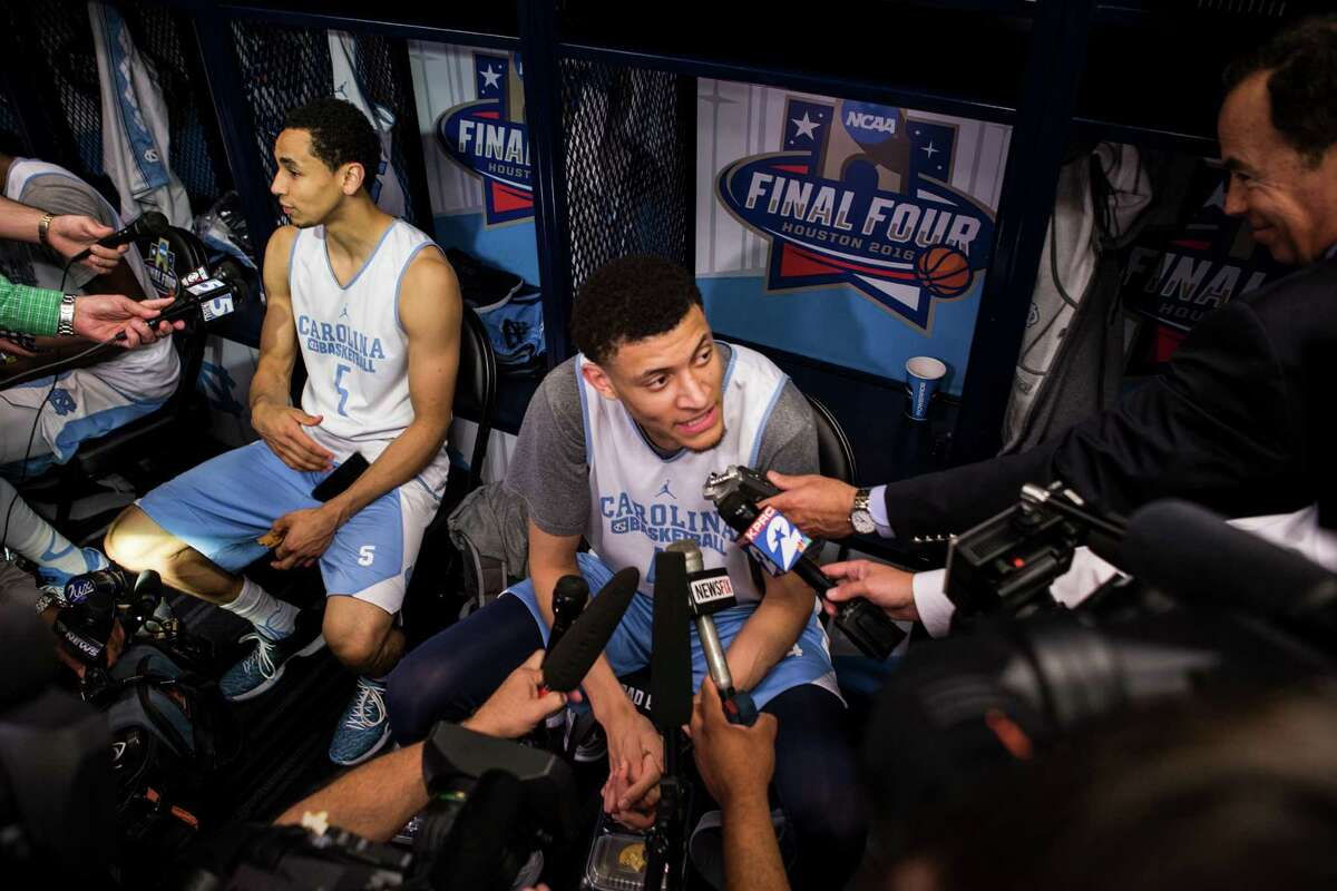 North Carolina guard Marcus Paige (5) and forward Justin Jackson (44) speak to reporters in the locker room following practice for the NCAA national semifinal at NRG Stadium on Thursday, March 31, 2016, in Houston.