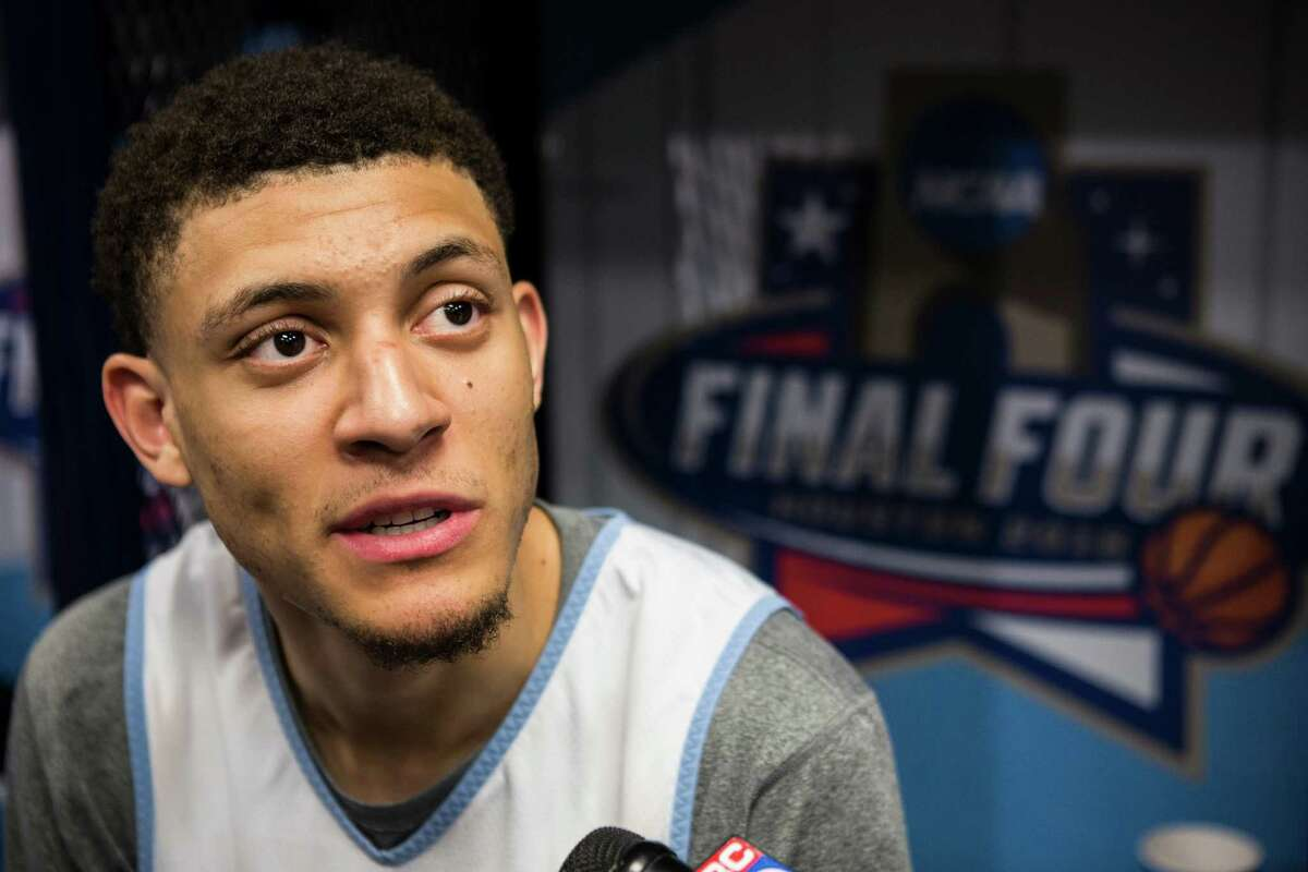 North Carolina forward Justin Jackson speaks to reporters in the locker room following practice for the NCAA national semifinal at NRG Stadium on Thursday, March 31, 2016, in Houston.