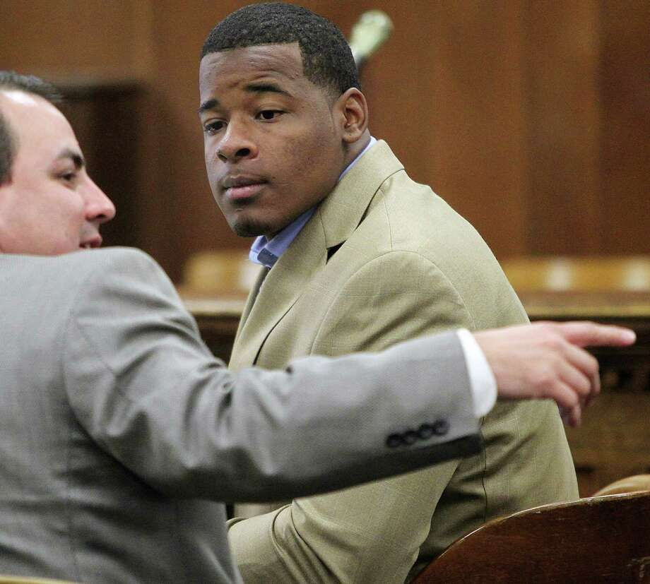 "FILE - In this Jan. 23, 2014, file photo, former Baylor football player Tevin Elliott waits with a unidentified lawyer in a McLennan county courtroom in Waco, Texas. A woman has filed a federal lawsuit against Baylor University contending that the largest Baptist school in the country was ""deliberately indifferent"" to sexual assault allegations against a former football player. The lawsuit alleges that Baylor failed to act against Tevin Elliott despite receiving six complaints from women claiming he assaulted them. Photo: Jerry Larson, AP / Waco Tribune Herald"