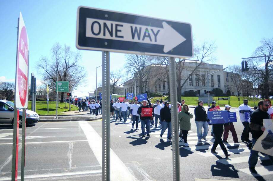 Hundreds of unionized state employees joined together to march outside of the state Capitol building to underscore how potential layoffs would affect Connecticut's quality of life. Photo: Michael Cummo / Hearst Connecticut Media / Stamford Advocate