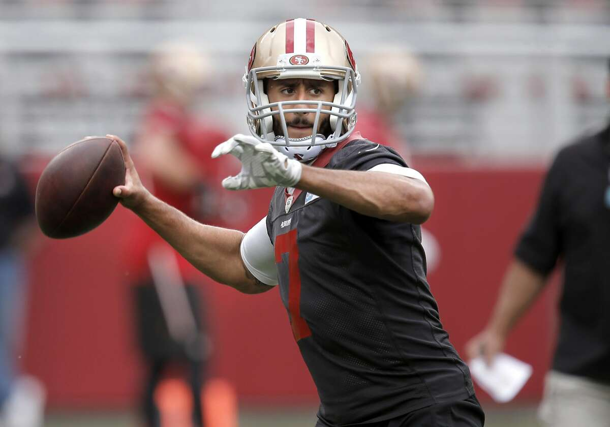 49er quarterback Colin Kaepernick, (7) looks to throw as the San Francisco 49ers open a three day mini camp at Levi's Stadium in Santa Clara in this June 9, 2015 file photo.The Broncos have reportedly been working on restructuring Colin Kaepernick's contract.