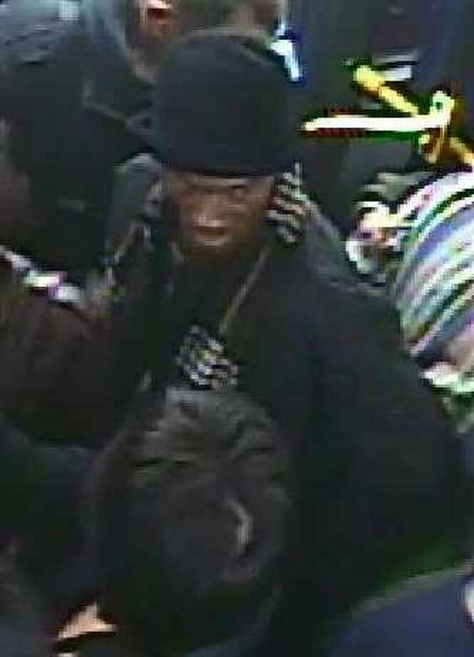San Francisco police are asking for the public's help identifying this man, who has a gold front tooth, after he stole a wallet from a man on a crowded Muni bus in January.