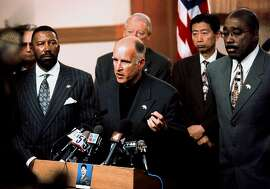 Oakland Mayor Jerry Brown, with City manager, Robert Bob, left, and Oakland Police Chief, Joseph Samuels, Jr., right, speaks at an afternoon  press conference Monday Jan.11, 1999, after the shooting of officer James Williams Jr. on Saturday.  A teacher's union voted Monday to go ahead with a death penalty teach-in focusing on a journalist convicted of killing a policeman despite criticism the event was inappropriate in light of the weekend shooting of the officer.      (AP Photo/Tribuune News, Nick Lammers)