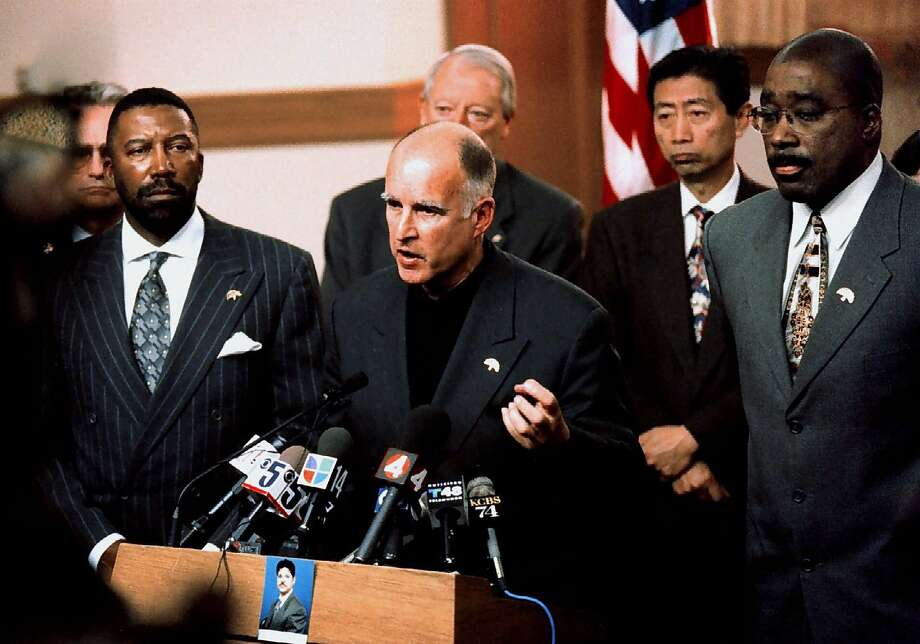 Oakland Mayor Jerry Brown, with City Manager Robert Bob, left, and Oakland Police Chief, Joseph Samuels Jr., right, speaks at an afternoon  press conference on Jan.11, 1999, after the shooting of Officer James Williams Jr.  Photo: NICK LAMMERS, AP