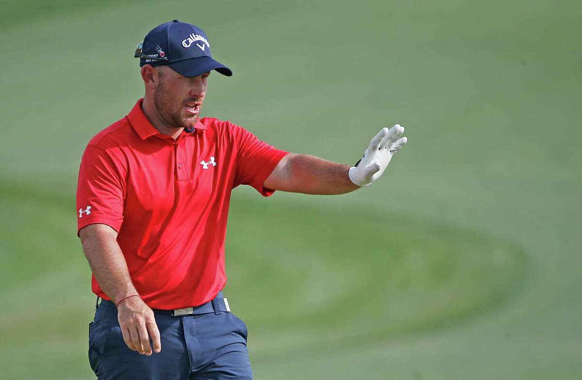 Scott Brown waves to the fans after finishing his round on the 18th hole in the Shell Houston Open-Round 1 at the Golf Club of Houston on Thursday, March 31, 2016 in Humble, TX.