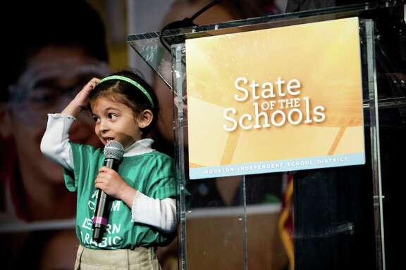 Arabic Immersion Magnet School kindergartener Leila Alborahi helps open the Houston Independent School District's State of The Schools event on  March 3. ( Brett Coomer / Houston Chronicle )