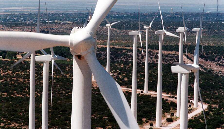 Sleek white wind turbines, 25 stories tall, rise from the plains of West Texas in Big Spring. Texas is one of the windiest states in the nation and the Panhandle and West Texas are the state's windiest regions. Photo: CAROLYN MARY BAUMAN, STF / KRT