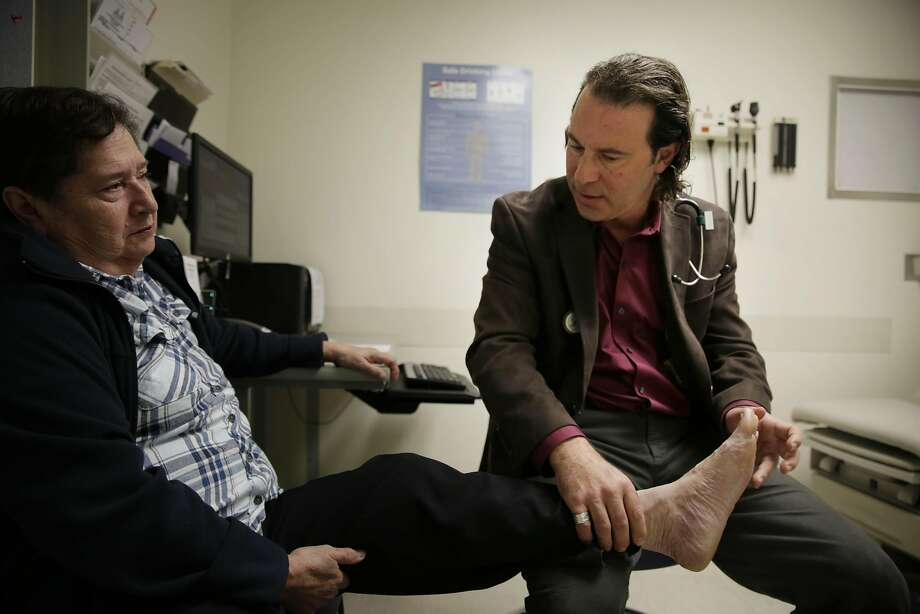 Dr. Dean Schillinger (right)  checks the swelling on the feet of Ruth Orozco (left) of San Francisco, who has diabetes, during a medical appointment at San Francisco General Hospital on Monday, February 22, 2016 in San Francisco, California. Photo: Lea Suzuki, The Chronicle