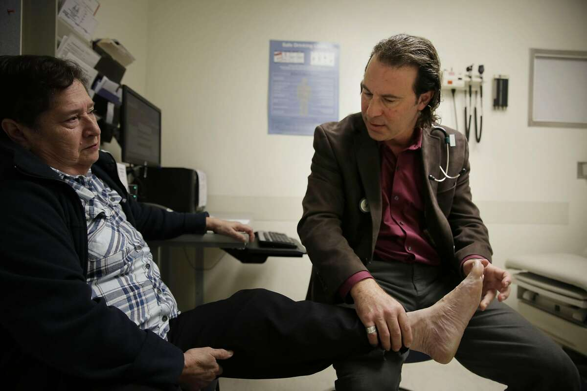 Dr. Dean Schillinger (right) checks the swelling on the feet of Ruth Orozco (left) of San Francisco, who has diabetes, during a medical appointment at San Francisco General Hospital on Monday, February 22, 2016 in San Francisco, California.