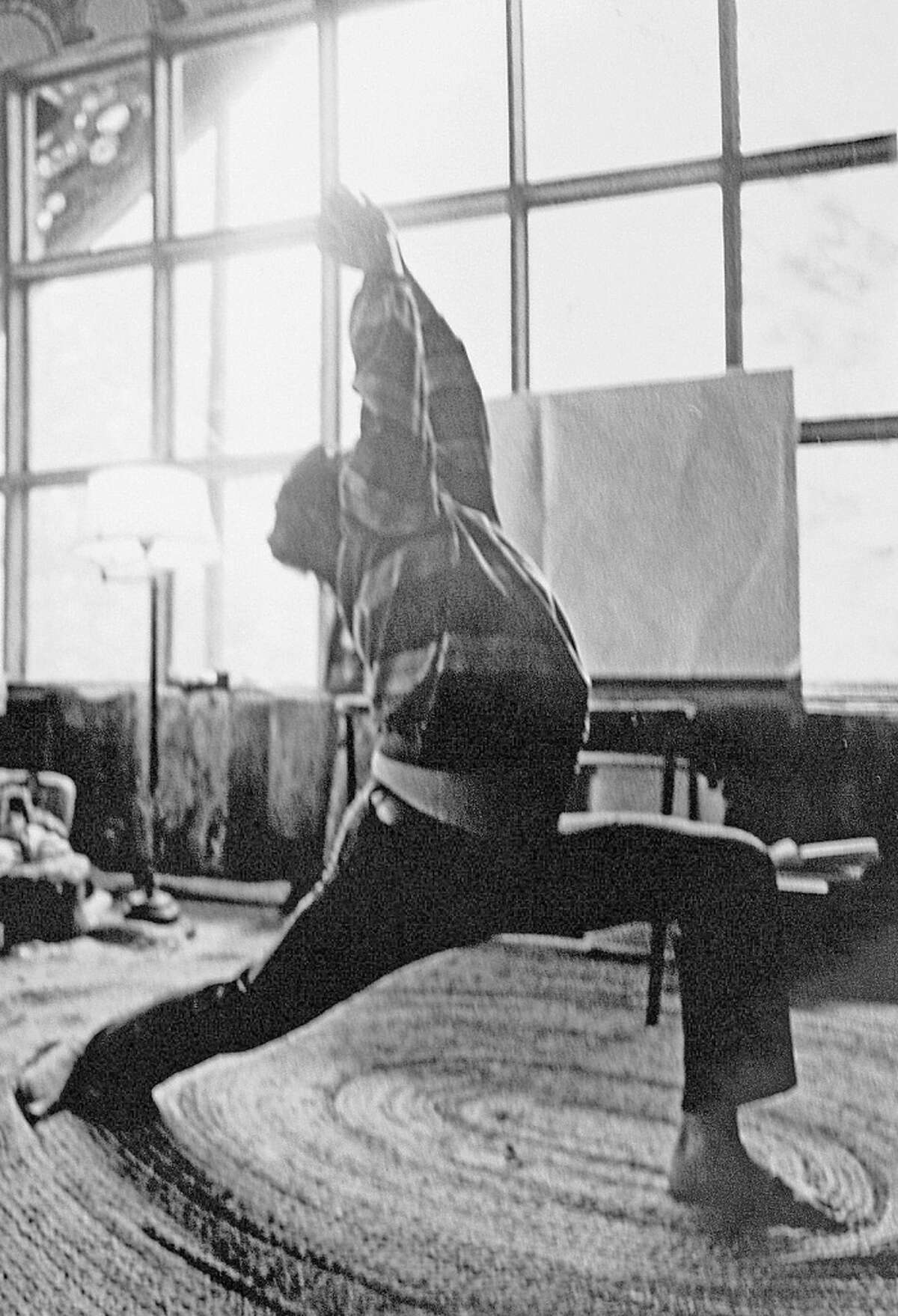 Labor activist Cesar Chavez relaxes by doing yoga routines at the United Farm Workers headquarters in La Paz in the 1970s.
